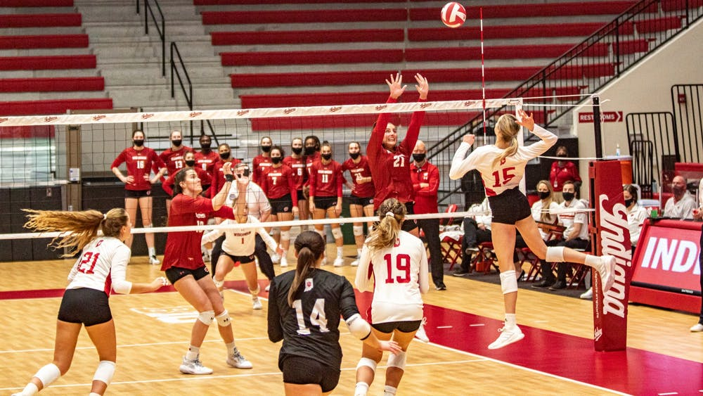 Freshman middle blocker Savannah Kjolhede spikes the ball Friday in Wilkinson Hall. IU lost to No. 1 Wisconsin 0-3.