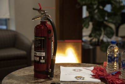A fire extinguisher sits on a table in Spruce Hall. IU organized a fire safety update Feb. 20 at Spruce Hall.