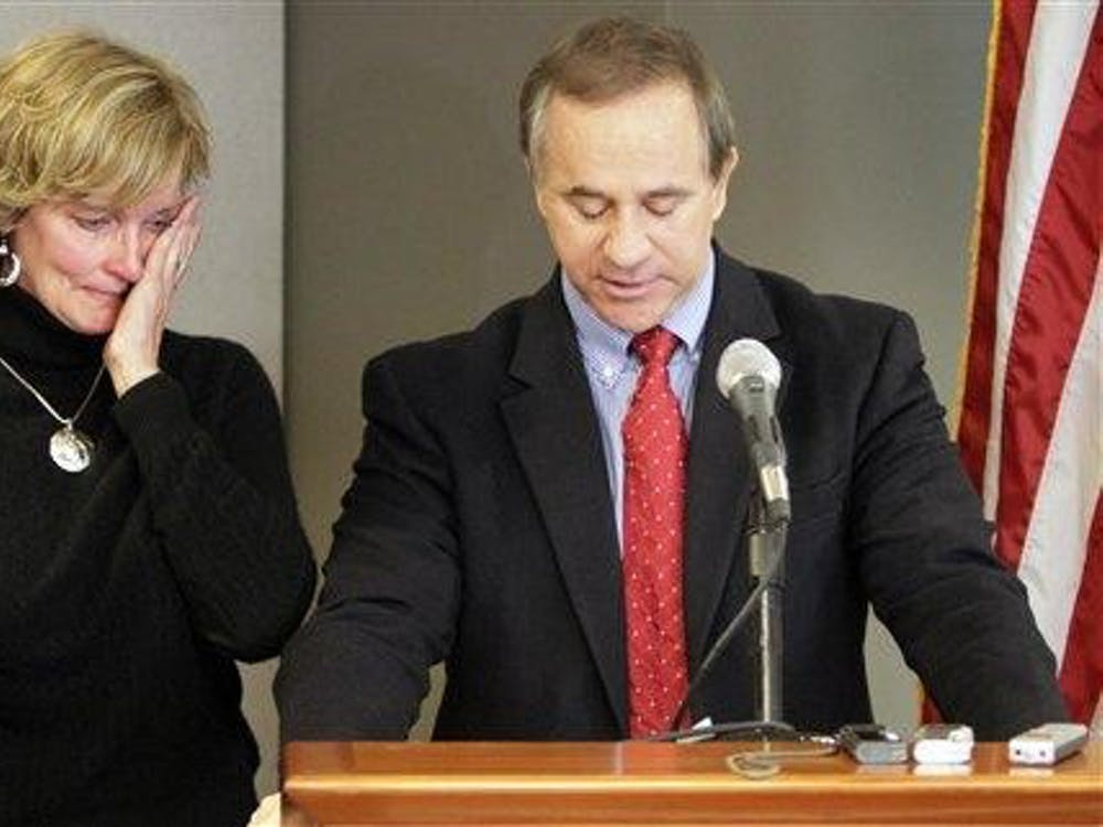 """U.S. Rep. Steve Buyer, R-Ind., right, announces he will not seek re-election because his wife, Joni, left, is ill during a news conference in Indianapolis on Friday. She has been diagnosed with an incurable autoimmune disease. """"As part of her prognosis she has been advised to de-stress her life,"""" he said. """"Now is the time for me to step back. It's been an honor."""" (AP Photo/AJ Mast)"""