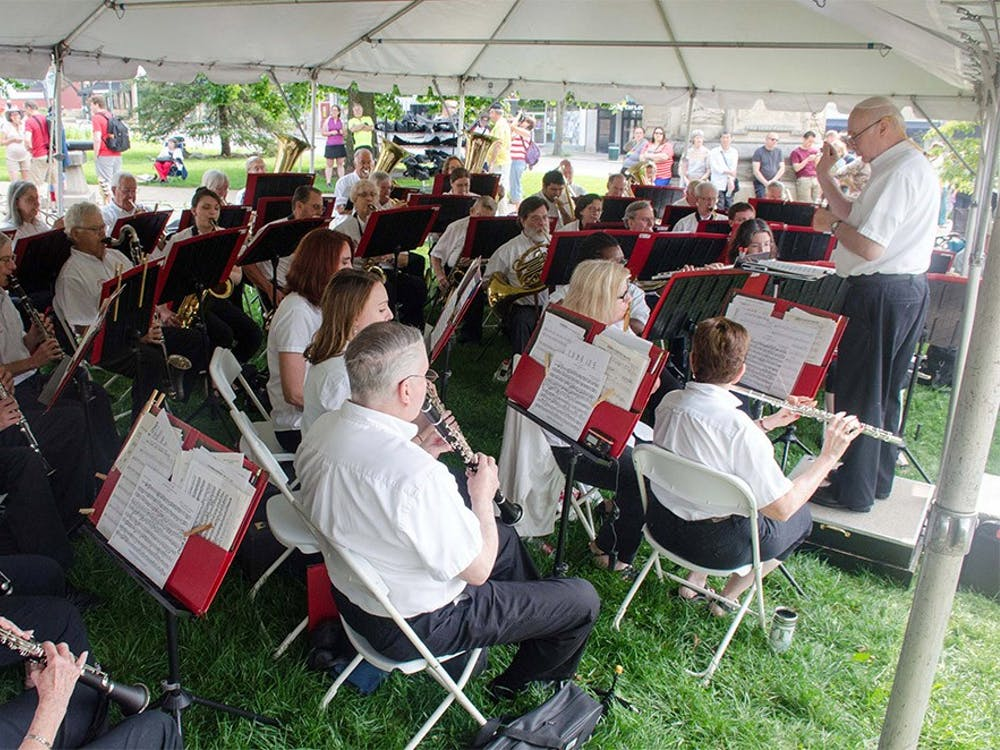 Bloomington Community Band perform at the July Fourth Pre-Parade Concert at the south side of the Bloomington Courthouse Square. The concert featured patriotic music, American classics, and favorite marches.