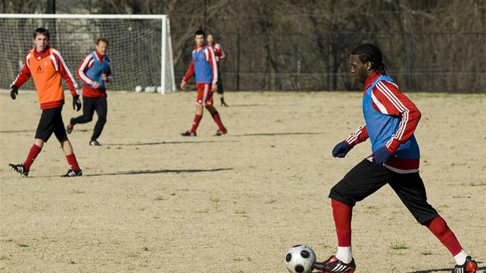 Senior back Ofori Sarkodie dribbles the ball across the pitch on Wednesday, April 8 at the soccer practice fields.