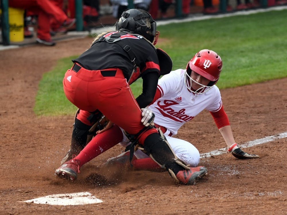 Then-freshman outfielder Taylor Lambert gets tagged out at the plate as she attempts to put IU's first points on the board April 18, 2018, at Andy Mohr Field. Lambert started all 19 games at centerfield for the Hoosiers last year before the 2020 season was cut short due to the COVID-19 pandemic.