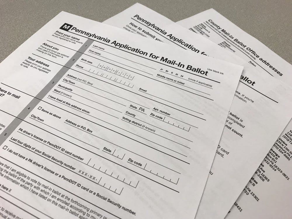 An application for a mail-in ballot sits on a table.
