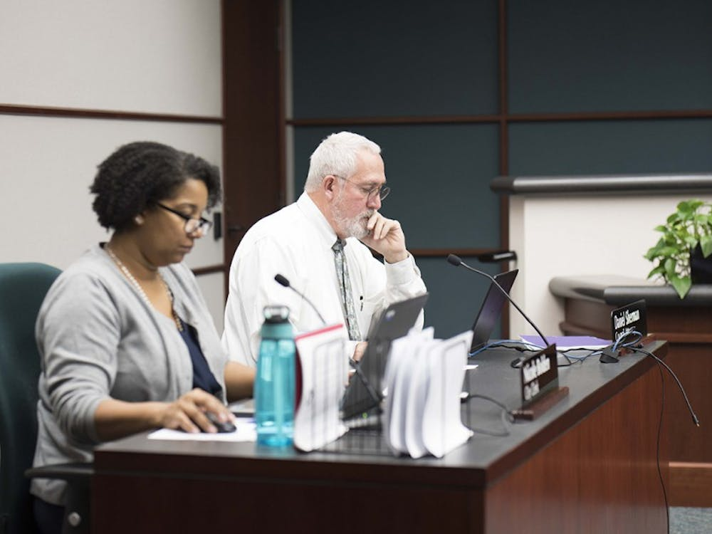 Daniel Sherman, coucil attorney, and Nicole Bolden, city clerk, prepare for the first city council meeting of the year. The meeting took place in the coucil chambers at City Hall Wednesday night.