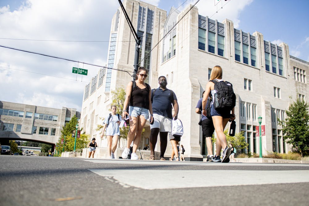 <p>Students cross the street at the corner of North Fee Lane and East 10th Street. Many are returning to in-person classes during the fall semester. </p>