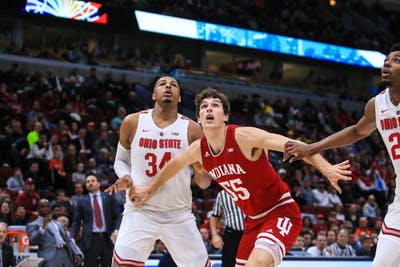 Senior forward Evan Fitzner watches the ball after Ohio State shoots a free throw March 14 during the Big Ten Men's Basketball Tournament in Chicago.