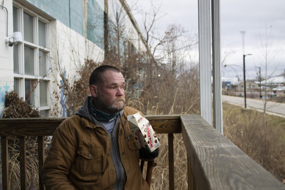 <p>Bloomington resident Jason &quot;Bubba&quot; Oliphant, 47, sits outside the new Beacon winter shelter near Switchyard Park on Jan. 26. Oliphant has been living at the shelter next door, A Friend&#x27;s Place, which is also run by Beacon. </p>