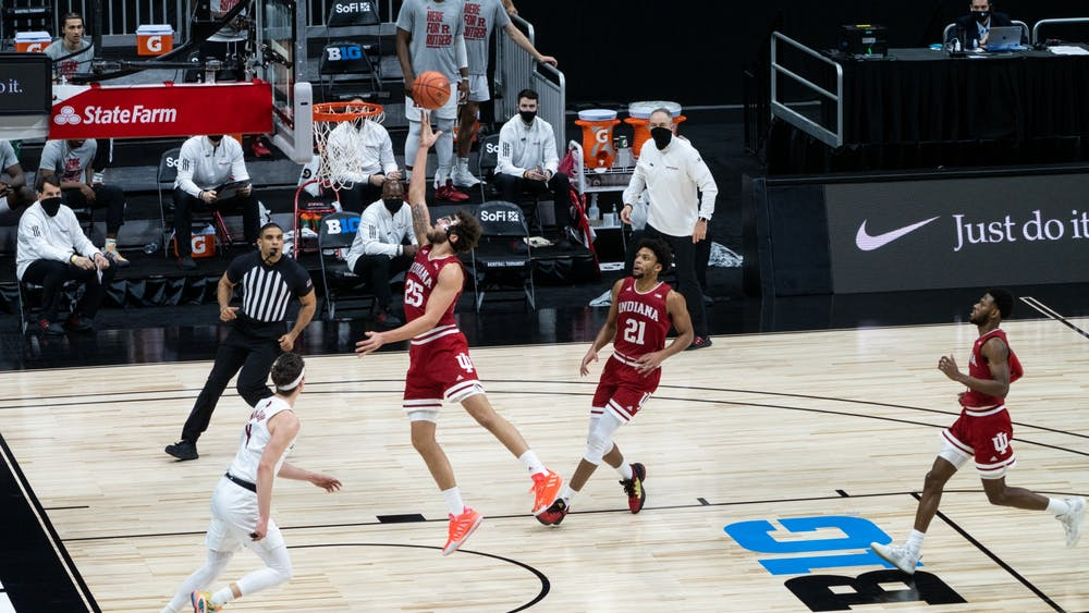 Redshirt junior forward Race Thompson goes up for a layup Thursday at Lucas Oil Stadium in Indianapolis. The Hoosiers lost 61-50 to Rutgers in the first round of the Big Ten Championships.