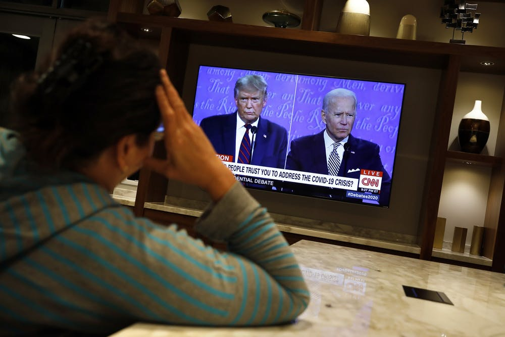 <p>A woman watches a TV as President Donald Trump and Democratic presidential nominee Joe Biden participate in the first presidential debate at the Health Education Campus of Case Western Reserve Universit Sept. 29in Cleveland, Ohio.</p>