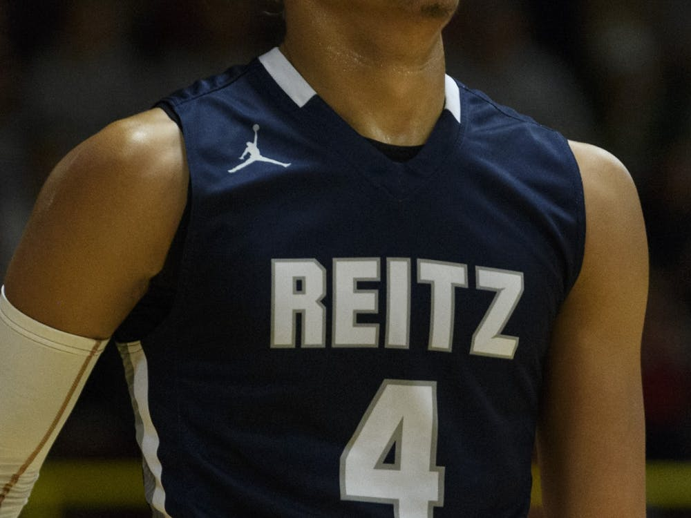 F.J. Reitz High School's Khristian Lander takes on the Mater Dei Wildcats on Dec. 13 at Mater Dei High School in Evansville, Indiana. According to 247sports, Lander, a five-star recruit and the No. 1 point guard in the country committed toIU.