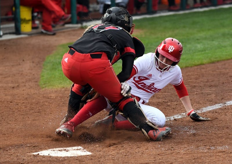 Then-freshman IU softball outfielder Taylor Lambert gets tagged out at the plate as she attempts to put IU's first points on the board April 18, 2018. IU will compete in the Wildcat Invitational on March 6-8 in Tucson, Arizona.