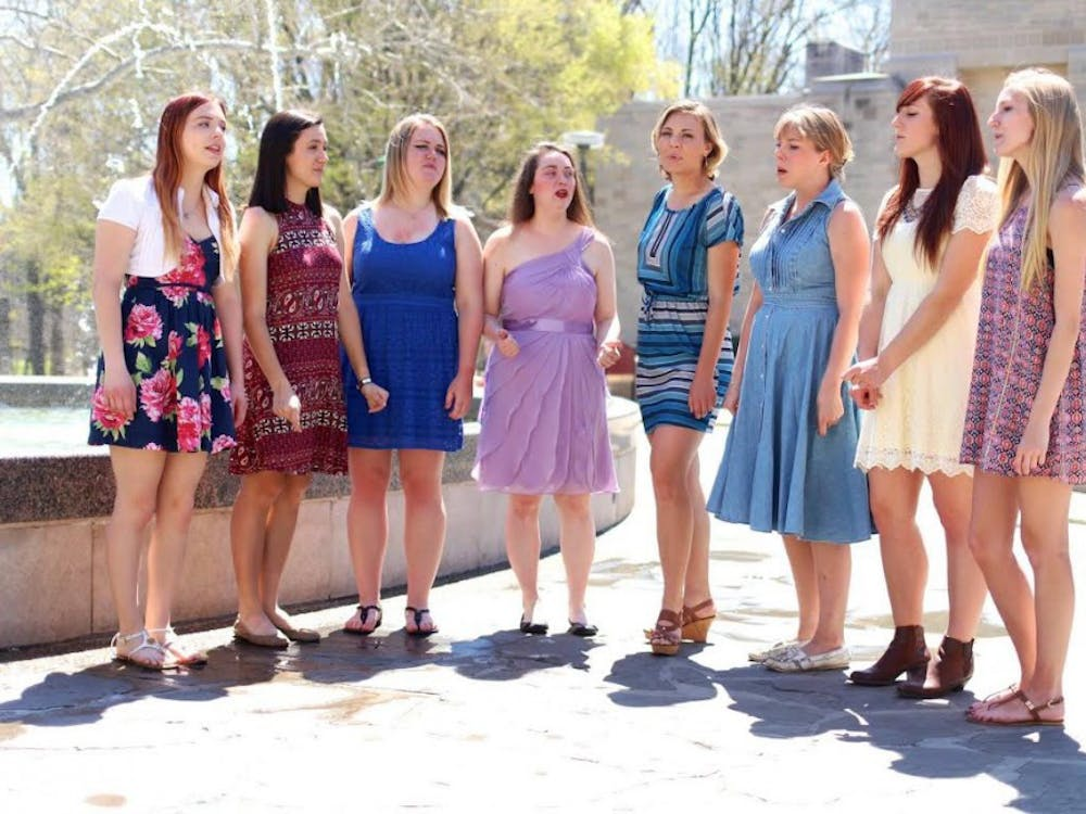 From left: Caitlin Jackson, Anna Hamilton, Maggie Reisdorf, Mary Levering, Hannah Pimley, Sara Klingseisen, Alexi King and Elizabeth Mitchell prepare for the Women in Music Festival. The festival begins today at Rhino's Youth Center.