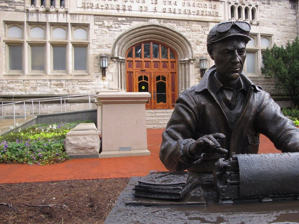 A statue of alumnus and World War II correspondent Ernie Pyle typing on his typewriter was installed in front of Franklin Hall on Oct. 9. The Media School, IU Bloomington's newest school combining telecommunications, journalism and communication and culture, will be inuagurated at Franklin Hall Friday.