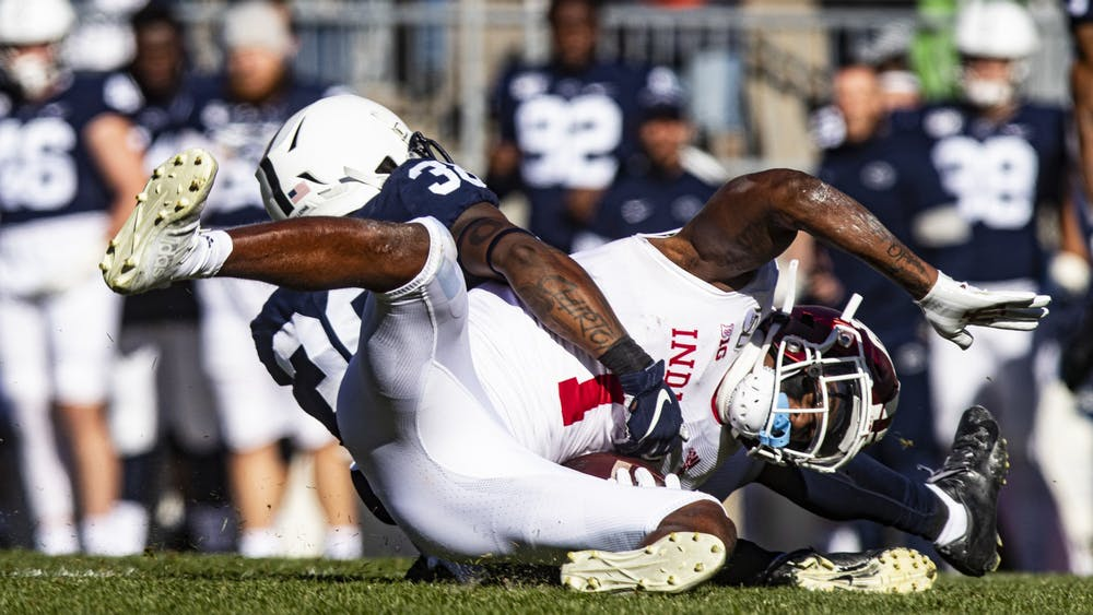 Junior wide receiver Whop Philyor gets tackled by Penn State junior safety Lamont Wade on Nov. 16 at Beaver Stadium. Philyor was tackled in the second quarter against Penn State.
