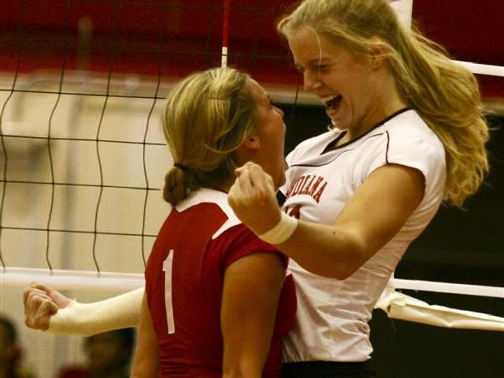 Senior Ashley Benson and junior Caitlin Cox celebrate a point during first round NCAA play Dec. 3 in University Gym. The Hoosiers worked through five sets against the Miami Hurricanes before advancing to the next round.