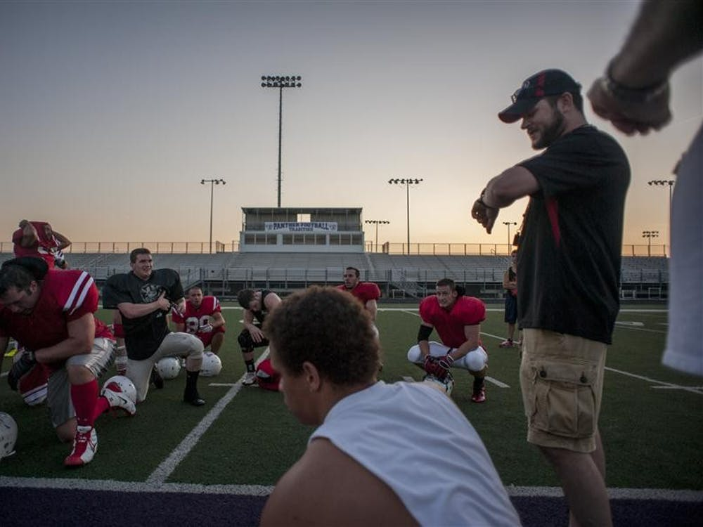 """McCool and team president John Shean glance at their watches as the Cutters catch their breath following the team's first full-contact practice at Bloomington South. """"This is becoming our core group. Men, you gotta get that intensity up,"""" McCool says. """"You think the Kentucky Xtreme are gonna take it easy on us?"""""""