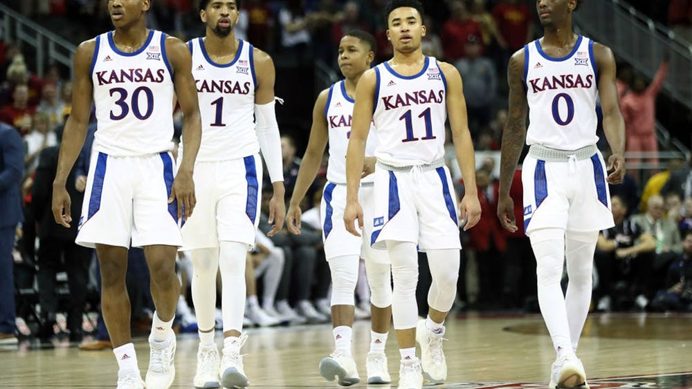 The Kansas Jayhawks walk onto the court after a timeout in the Big 12 Tournament Finals against the Iowa State Cyclones at Sprint Center on March 16, 2019 in Kansas City, Missouri.