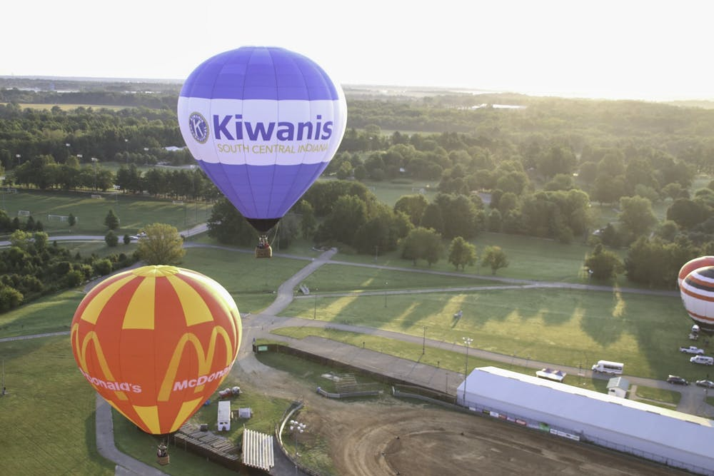 <p>Hot air balloons fly in the air Sept. 10, 2021. The Kiwanis Indiana Balloon Festival began Sept. 10 and ends Sept. 12.</p>