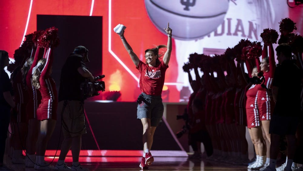 Senior Brenna Wise dances as she is introduced Oct. 5 in Simon Skjodt Assembly Hall. Wise threw kisses into the crowd as she walked into the center of the court.