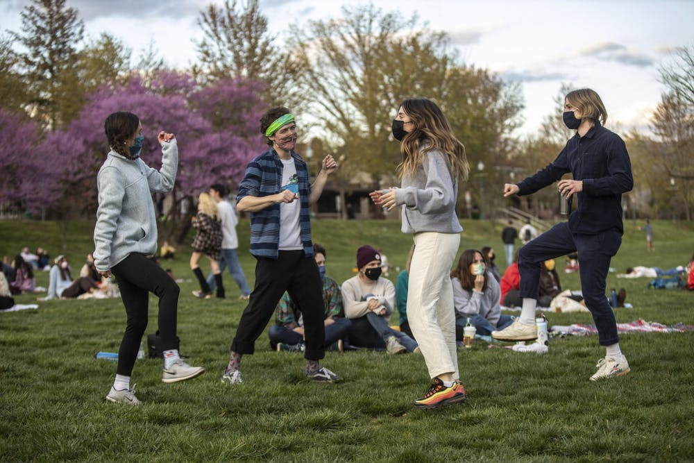 <p>Then-juniors Sydney Johnson and Emery Hightower, then-sophomore Ollie Grcich and then-senior Sam Boland, co-president of Bloomington Delta Music Club, dance during the BDMC Presents concert April 15, 2021, in Dunn Meadow. The first &quot;Swing in September&quot; concert will take place Sept. 3, 2021, in Dunn Meadow.</p>
