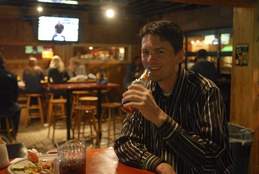 Libertarian Greg Knott drinks a beer Tuesday at Kilroys on Kirkwood. The graduate of Edgewood High School and bachelor in public affairs at IU's SPEA program ran for 9th District for the US House of Representatives.