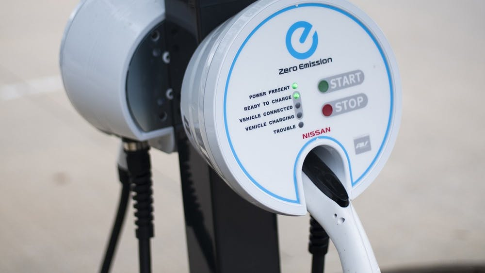 New electric car chargers stand in front of the Cyberinfrastructure building at 10th Street and Indiana 46 Bypass. The charging stations were recently installed to help employees with electric cars get to and from work.