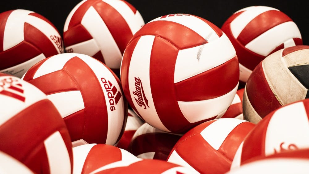 Volleyballs are stacked in a basket June 19 in Wilkinson Hall. IU will play Illinois on Oct. 4 at home.