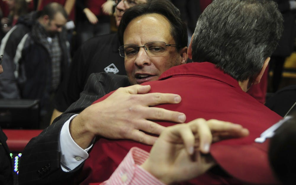 IU head coach Tom Crean hugs athletics director Fred Glass during the Hoosiers' 52-49 victory over Illinois on Thursday, Jan. 23, 2011 at Assembly Hall.