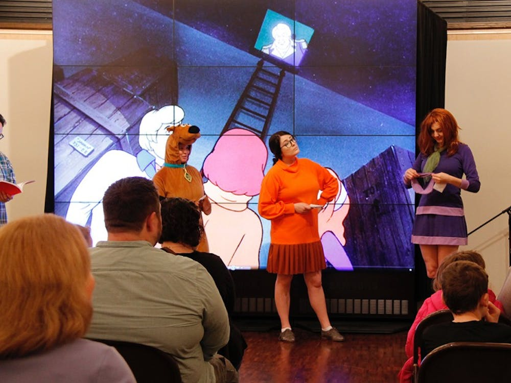 """Scooby-Doo, Velma and Daphne, played by student cosplayers Kristen Pimley, Erin Garman and Alexa Lively, led efforts to solve the mystery of the missing butter churn during the """"Mystery at the Museum"""" event Sunday afternoon at Mathers."""