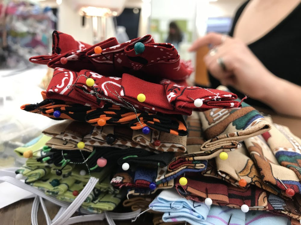 <p>A pile of masks sits on a table Oct. 30 at College Mall. </p>