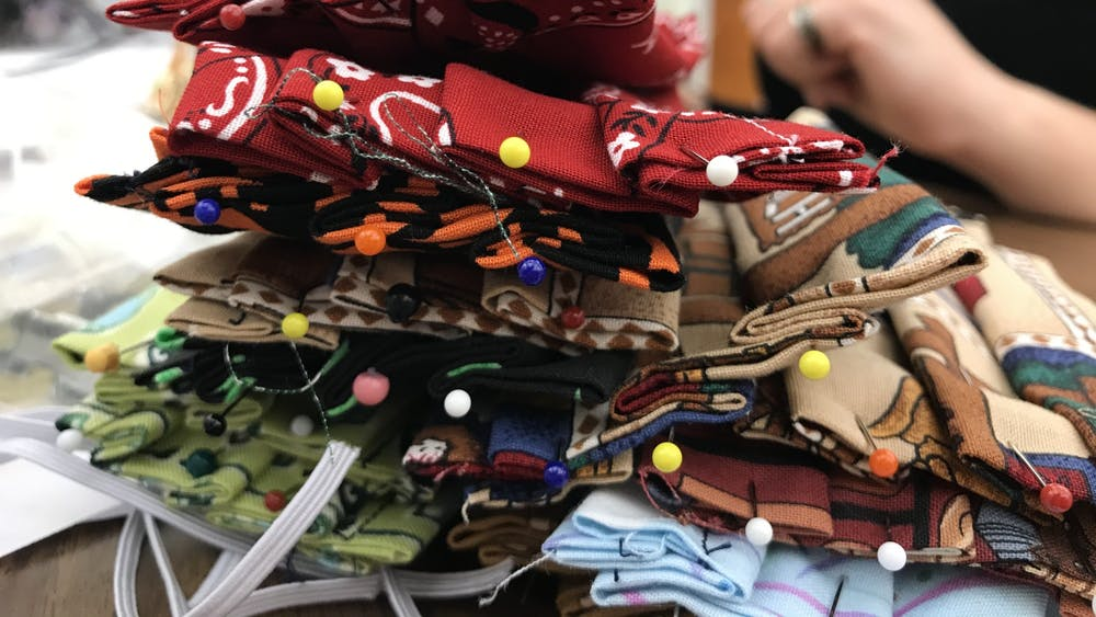 A pile of masks sits on a table Oct. 30 at College Mall.
