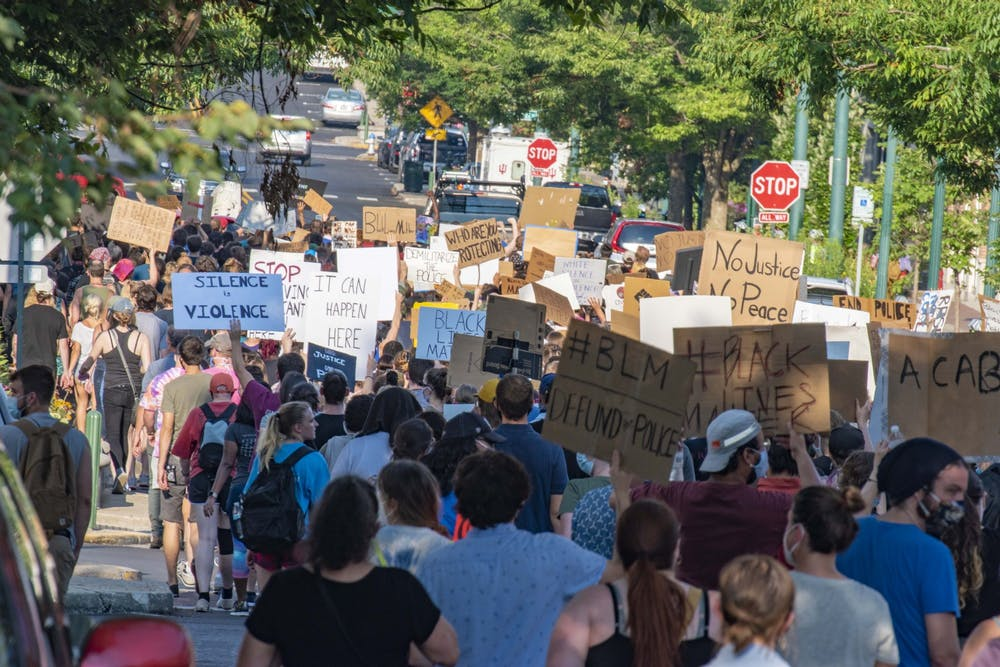 <p>A group of protesters march in Bloomington on July 7 in support of Black Lives Matter. There were more than 300 demonstrations in Indiana in 2020. </p>