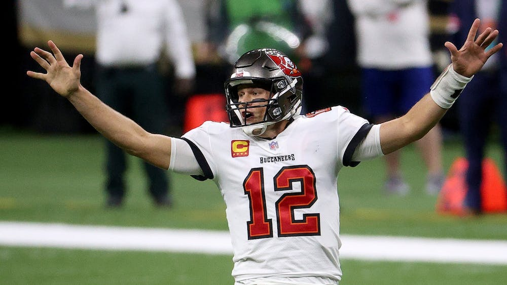 Tampa Bay Buccaneers quarterback Tom  Brady celebrates a first down against the New Orleans Saints late in the fourth quarter of the NFC Divisional Playoff game Jan. 17 at Mercedes-Benz Superdome in New Orleans. The Buccaneers won the game 30-20 to move onto the NFC Championship game.