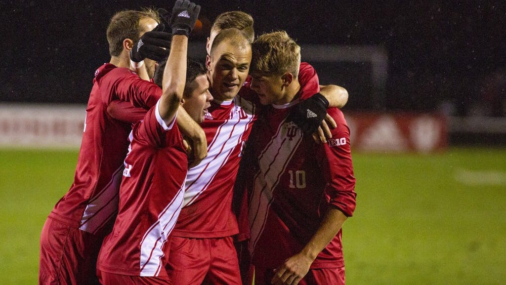 The IU men's soccer team celebrates after senior defender Andrew Gutman, middle, scores the first goal Oct. 12 at Bill Armstrong Stadium. Gutman also scored the game-winning goal late in the second half to help IU defeat Maryland, 2-1.