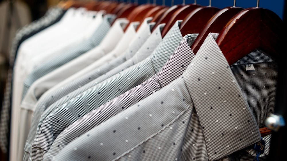 Dress shirts line the racks June 10, 2019 at State and Liberty Clothing in Ann Arbor, Michigan.