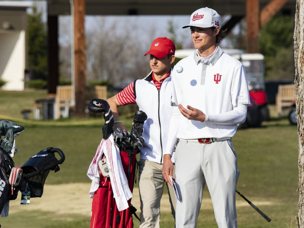 Senior Ethan Shepherd tosses a golf ball in the air before teeing off Sunday during the Hoosier Collegiate Invitational at the Pfau Course in Bloomington. The Hoosiers finished second in the invitational Sunday.