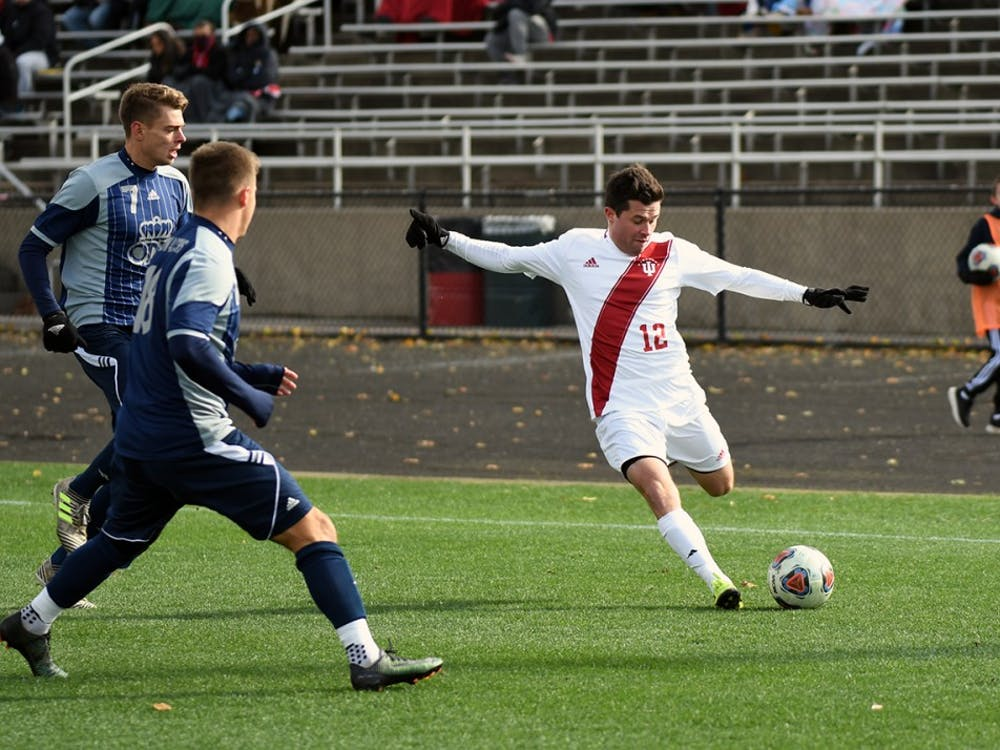 Junior midfielder Austin Panchot kicks the ball against Old Dominion in the second round of the NCAA Tournament on Sunday afternoon at Bill Armstrong Stadium. Panchot scored IU's third goal of the match in the Hoosiers' 3-0 win against Old Dominion.