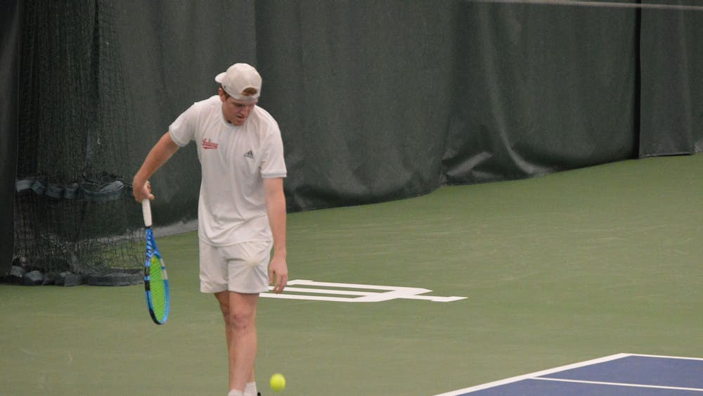 Then junior Patrick Fletchall prepares to serve the ball on April 11 at the IU Tennis Center. Fletchall won his tournament this past weekend in Indianapolis.