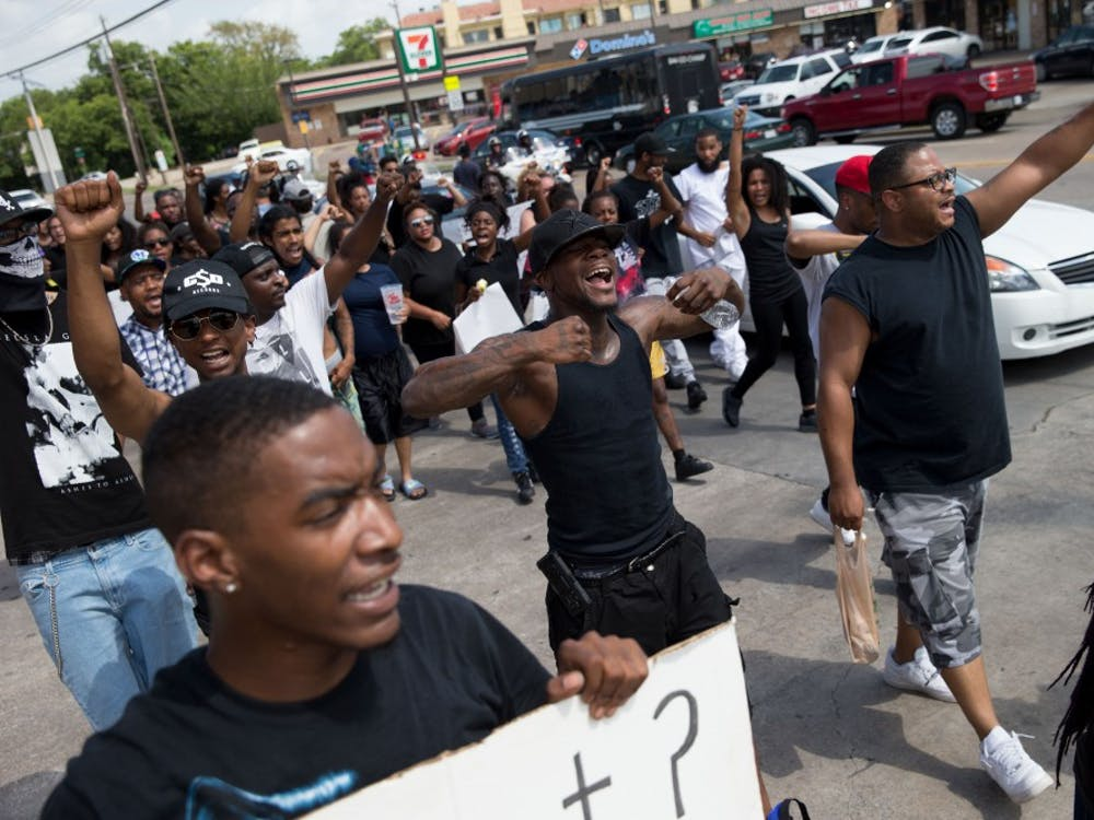 WEB USE BY TNS CONTRIBUTORS ONLY; MANDATORY CREDIT -- Black Lives Matter protesters march down Park Lane in Dallas on Sunday, July 10, 2016. (Ting Shen/Dallas Morning News/TNS)