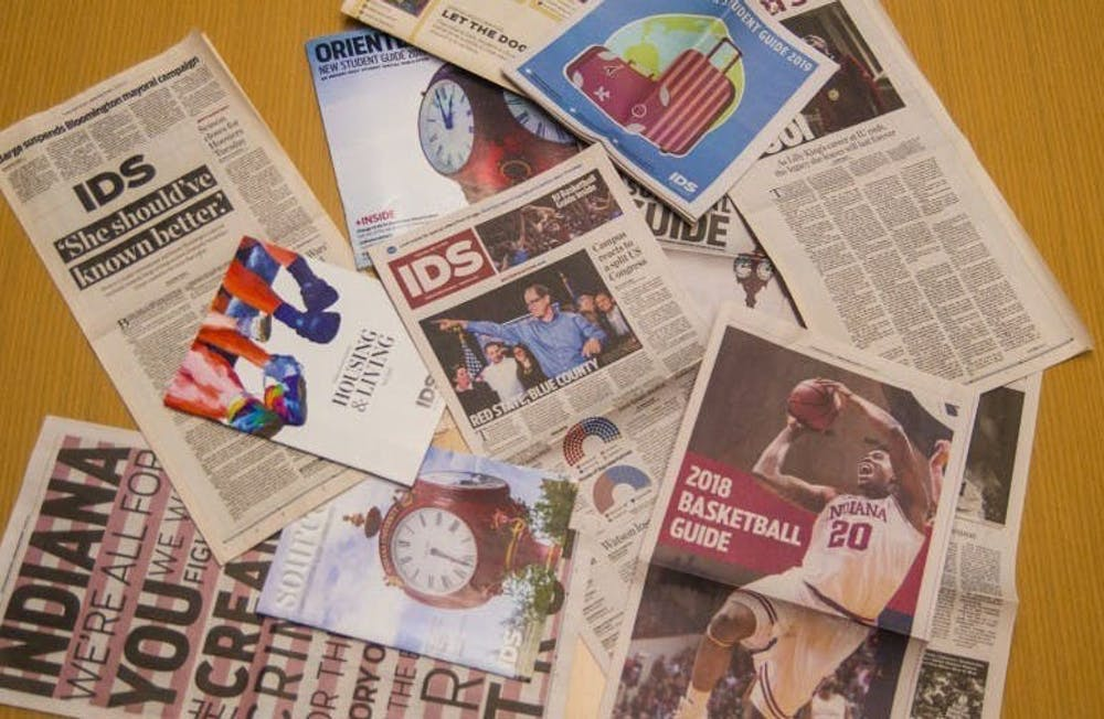 <p>A collection of Indiana Daily Student publications lie on a table. The print edition of the paper will be published once per week this fall.</p>