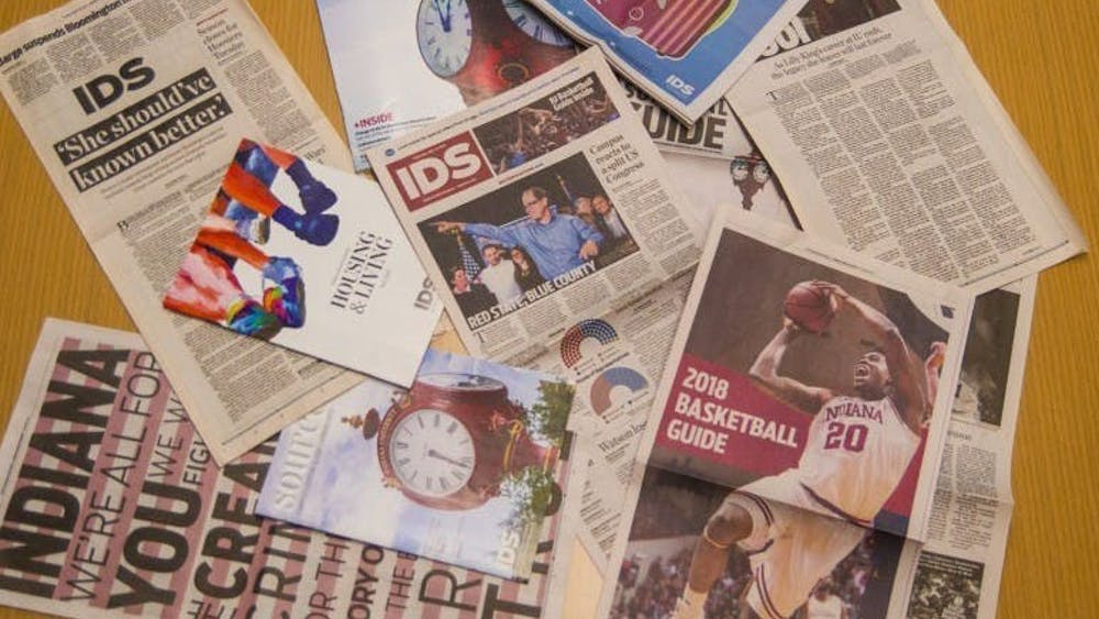 A collection of Indiana Daily Student publications lie on a table. The print edition of the paper will be published once per week this fall.