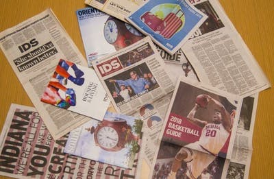 A collection of Indiana Daily Student publications lay on a table. The print edition of the paper will be published once per week this fall.