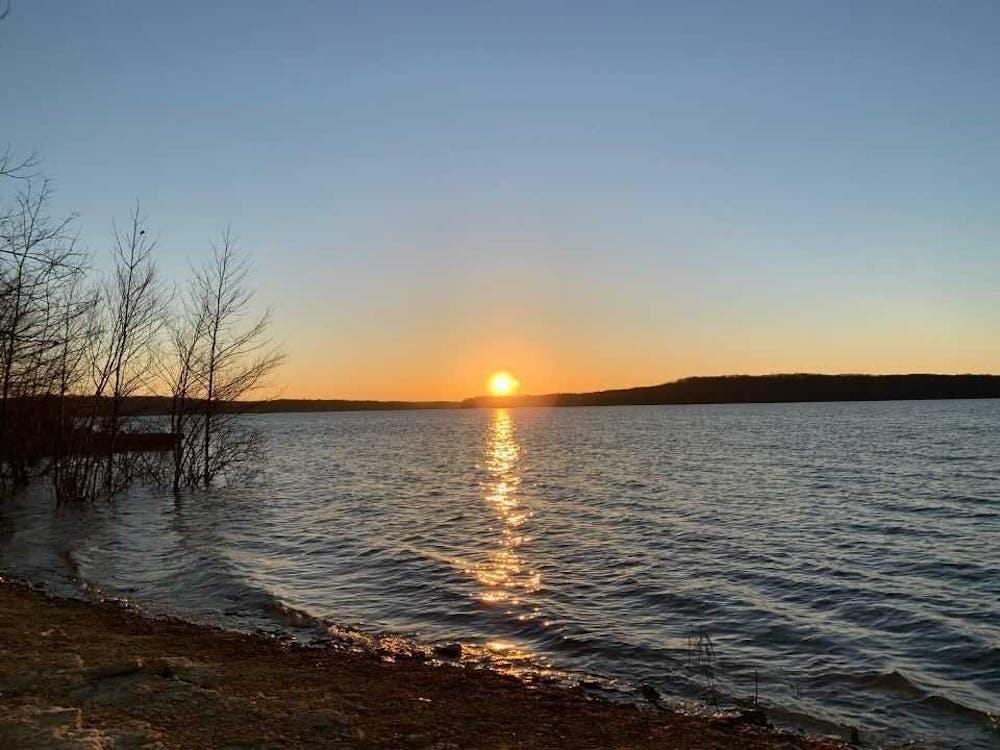 The sun rises March 30 on Lake Monroe.