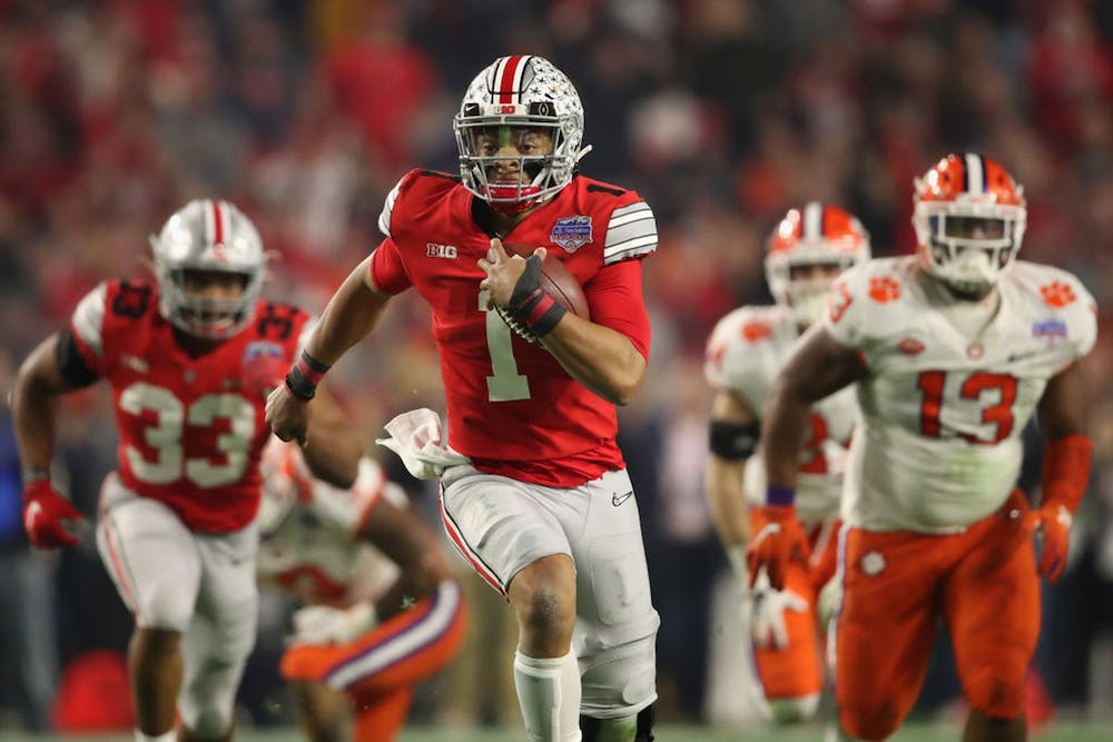 <p>Then-junior quarterback Justin Fields from Ohio State scrambles with the football during the PlayStation Fiesta Bowl against Clemson University on Dec. 28, 2019 at State Farm Stadium in Glendale, Arizona. Fields has started a movement asking the Big Ten to reverse its decision to postpone the fall football season.</p>