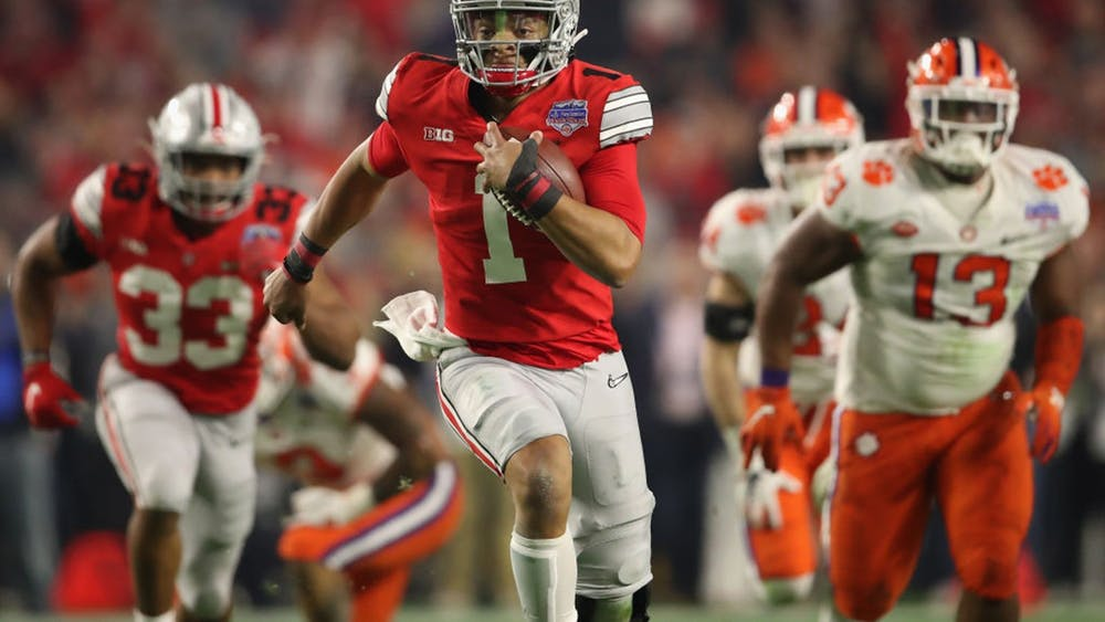 Then-junior quarterback Justin Fields from Ohio State scrambles with the football during the PlayStation Fiesta Bowl against Clemson University on Dec. 28, 2019 at State Farm Stadium in Glendale, Arizona. Fields has started a movement asking the Big Ten to reverse its decision to postpone the fall football season.