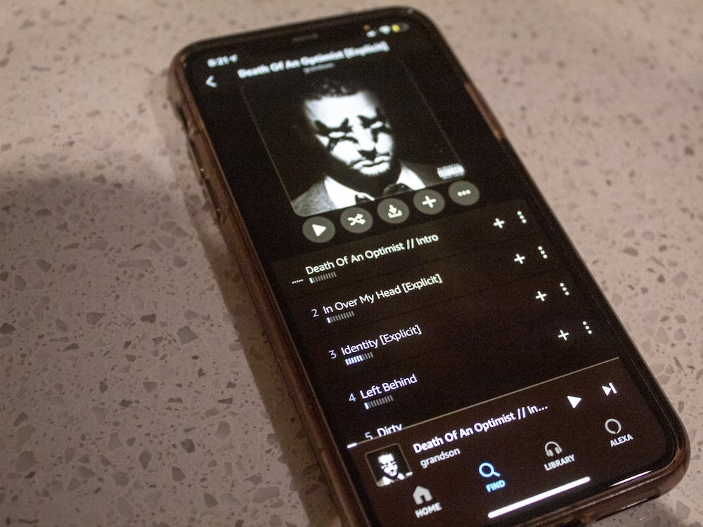 """An iPhone displaying Grandson's album """"Death of an Optimist"""" sits Dec. 9 on a counter."""