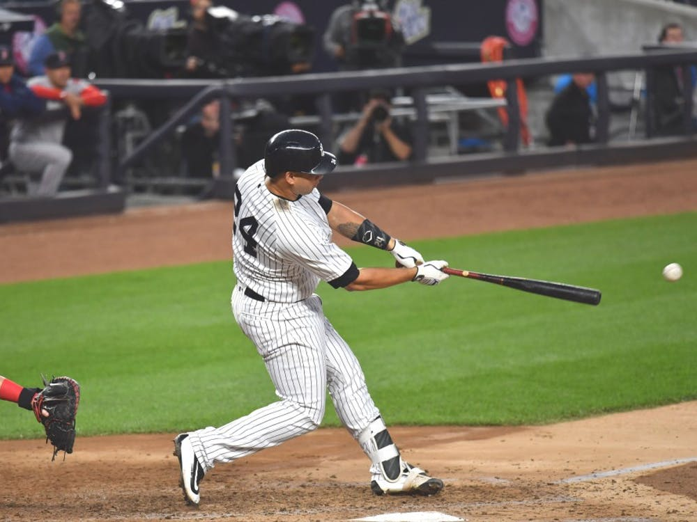 The New York Yankees' Gary Sanchez hits the first of two home runs against the Boston Red Sox on June 8 at Yankee Stadium in New York. The Red Sox-Yankees rivalry has intensified after it was discovered that Boston used an Apple watch to help steal signs against New York earlier this week.