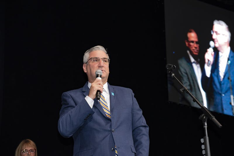 Indiana Gov. Eric Holcomb speaks at the 2018 State GOP Convention. Holcomb confirmed Monday that Indiana had its first COVID-19-related death.