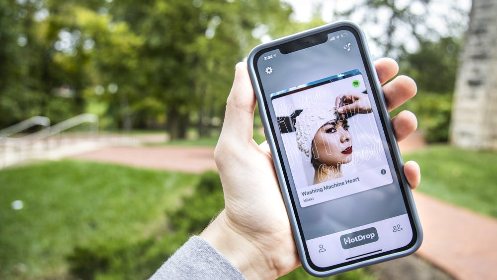 The HotDrop app is seen on a phone Oct. 12, 2021, outside of Franklin Hall. Two IU juniors launched the new app Sept. 29, 2021, to help users discover and share songs with friends.