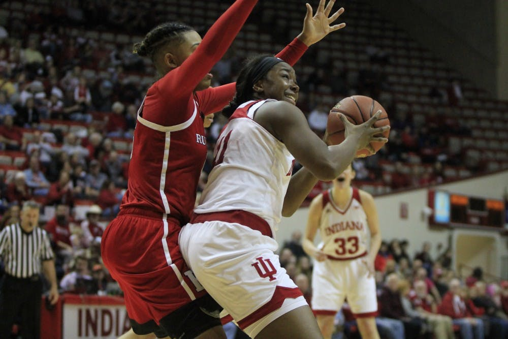 Junior forward Kym Royster guards the ball from her Rutgers University opponent on Saturday, Jan. 27, at Simon Skjodt Assembly Hall. IU defeated Rutgers University 64-58.